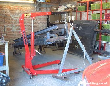 Engine hoist used to lift chassis