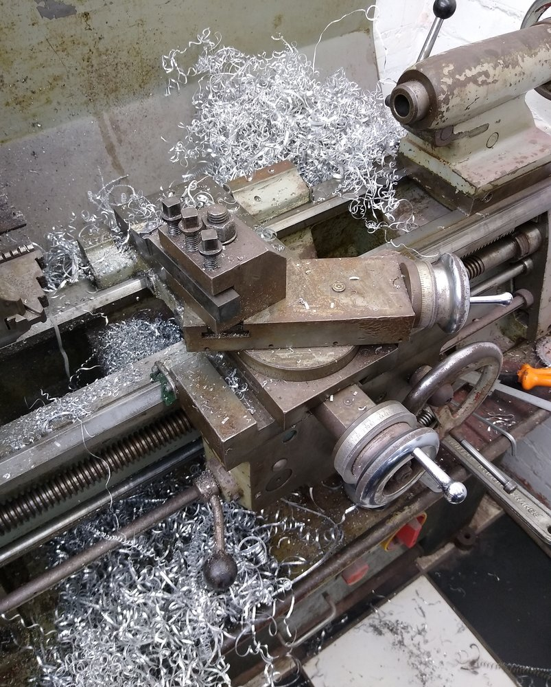 lathe mess after maching thermo housing.jpg